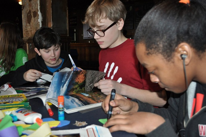 Students work on an art piece at Serve2Unite Winter Peace Summit 2014. (Photo by Kayla Parker)