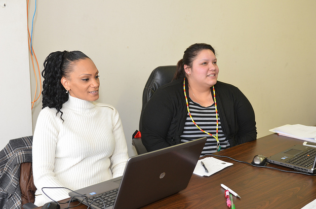 Application counselor Selena Roberts (left) and Shendola Duke (right) work at an Affordable Care Act sign-up event at the Gerald L. Ignace Indian Health Center. (Photo by Sue Vliet)