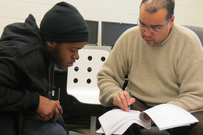 Kabon Jones (left) and Jose Lovo discuss plans for a job training program that will best fit Jones' needs.
