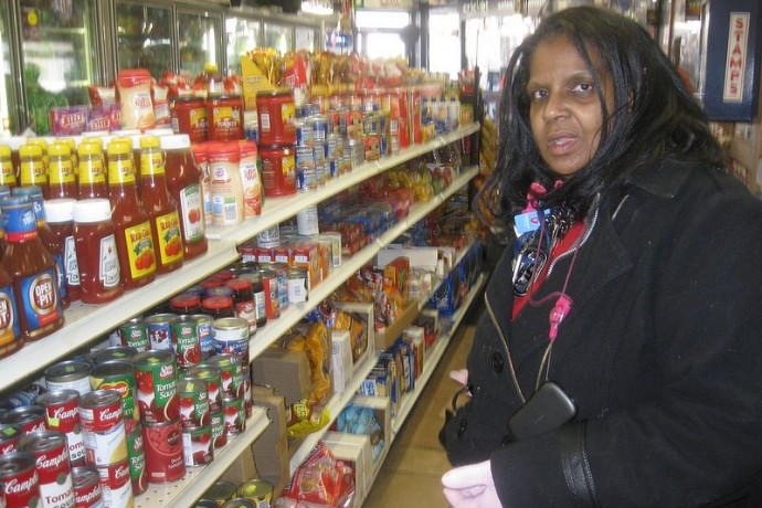 Gwendolyn Weathers-Ford, a FoodShare recipient, shops at City Spirits & Liquor, a convenience store at 1535 W. North Ave. (Photo by Brendan O'Brien)