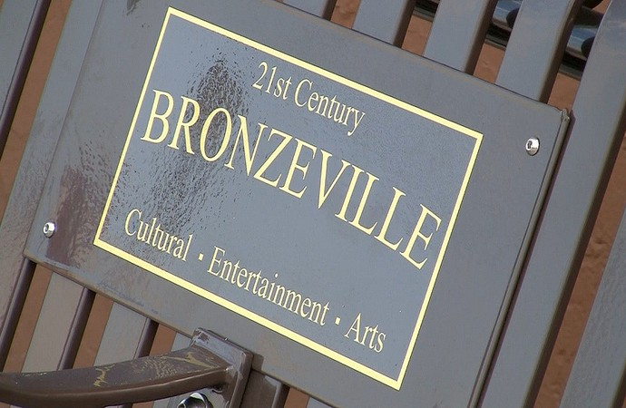 "Plaques on North Avenue identify the ""21st Century Bronzeville"" redevelopment area. (Photo by Mark Doremus)"