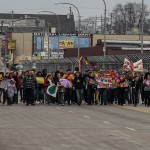 Community members march across bridge to stop violence