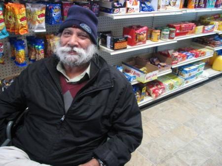 Jaswinder Natt owns Natt Groceries, 401 N. 35th St., in the Merrill Park neighborhood with his son Arshpreet. (Photo by Brendan O'Brien)
