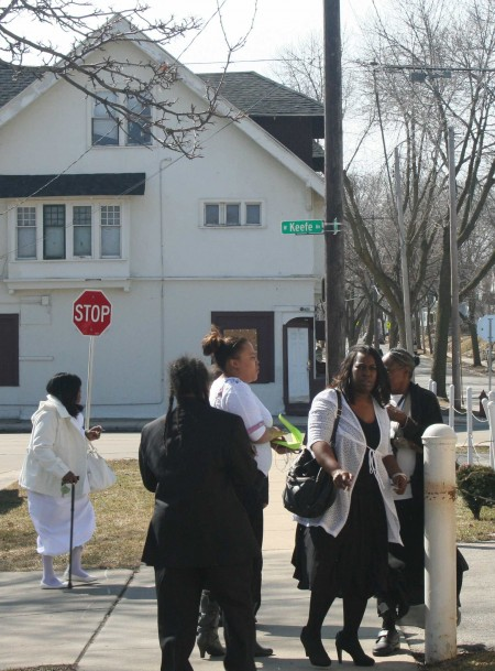 Church attendees gather outside True Love Missionary Baptist, Sunday morning, across the street from 3478 N. 2nd. (Photo by Jabril Faraj)