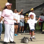 African Americans walk through city neighborhoods to promote health equity