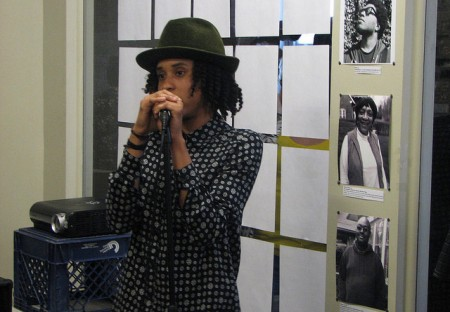 "Cierra McKissick addresses the audience at the ""I Am Milwaukee Home"" photo show. (Photo by Brittany Carloni)"