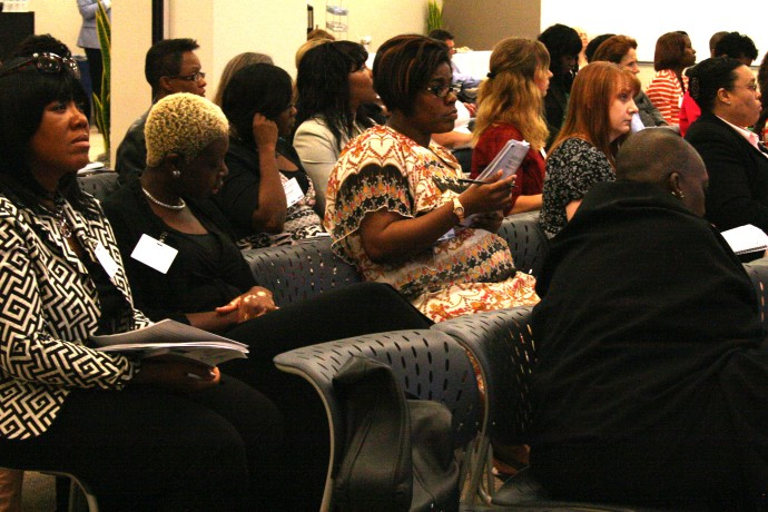 Participants listen to a presentation about strategic research and marketing. (Photo by Hannah Byron)