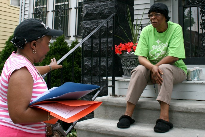 Volunteer Sandra White asks May Dunson her opinion about prison reform. (Photo by Hannah Byron)