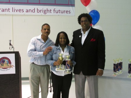 Education Initiative assistant Tracy Revels (left) and Education Specialist Darrell Finch (right) congratulated student of the year Jada McMillian. (Photo by Brittany Carloni)