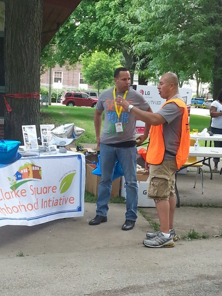 Ramon Candelaria chats with volunteer Anthony Mercado during the summer's Serve Your City Day. (Photo by Raina J. Johnson)