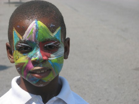 A young man displays his face paint at the Bronzeville festival. (Photo by Brendan O'Brien)