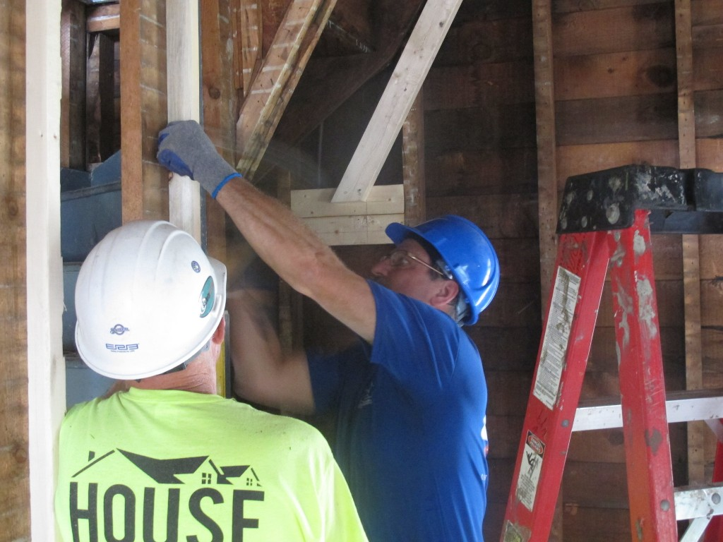 Lowe's volunteers work on framing a new home in Washington Park. (Photo by Patrick Leary)