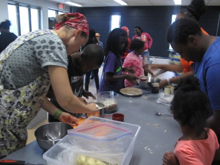 Volunteers make pies at the Urban Ecology Center. (Photo by Karen Stokes)