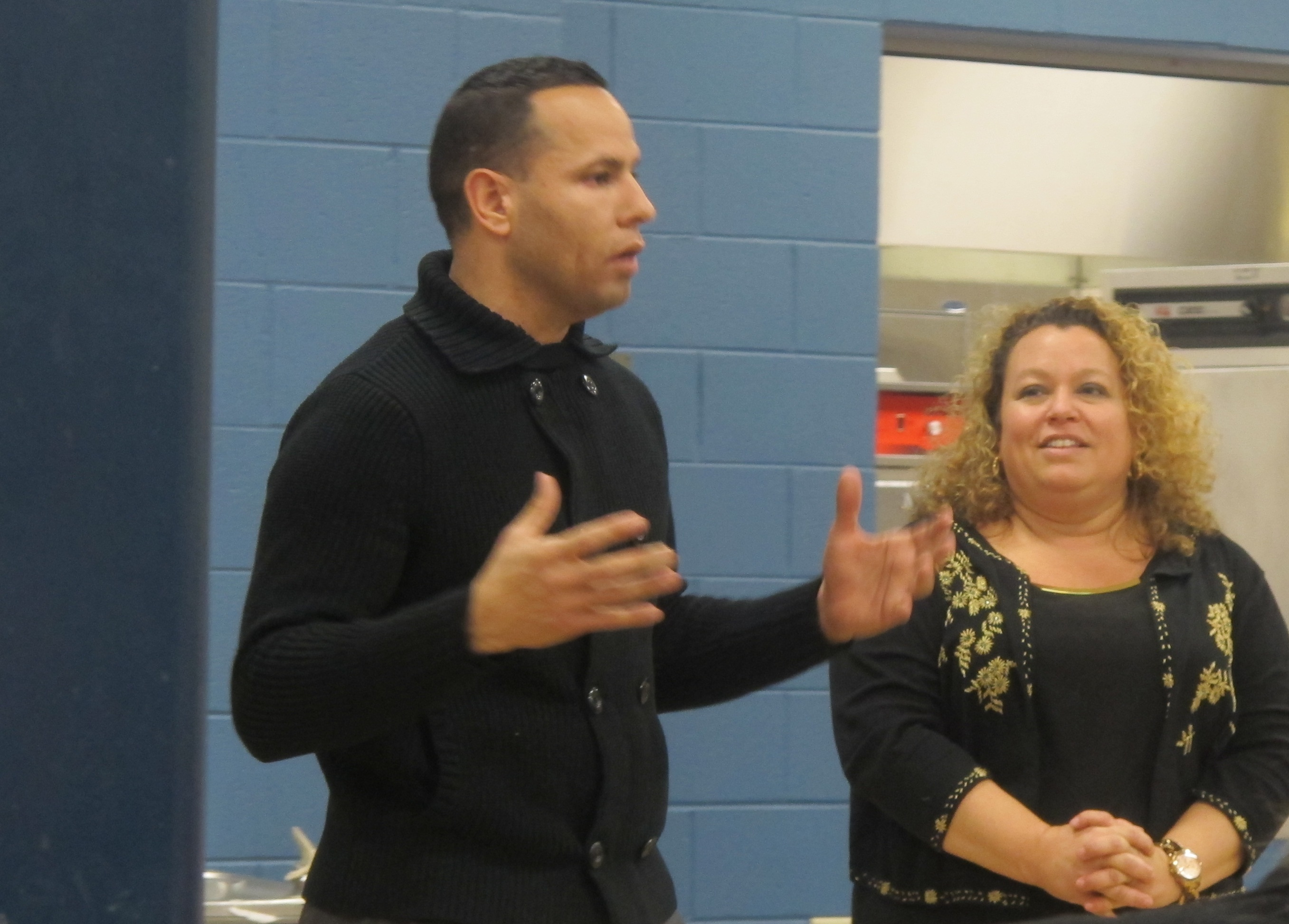 Ramon Candelaria, with Journey House Executive Director Michele Bria, spoke to community members about a new GED test in November 2013. (Photo by Edgar Mendez)