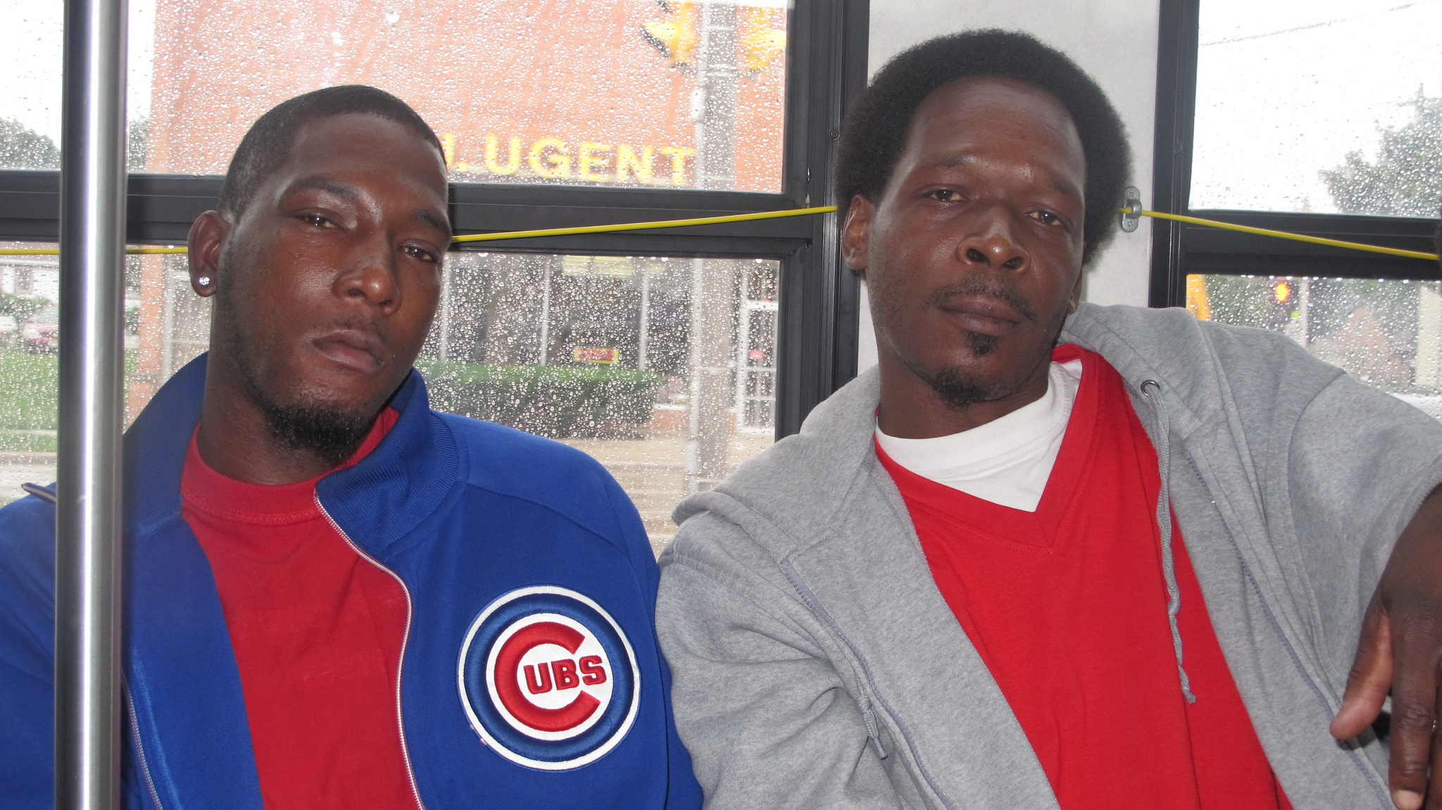 Jovan Armstrong (left) and Frederick Williams take the new Route 6 bus from the first stop at Port Washington Road and Capitol Drive to the last stop at BuySeasons in New Berlin to apply for jobs. (Photo by Andrea Waxman)