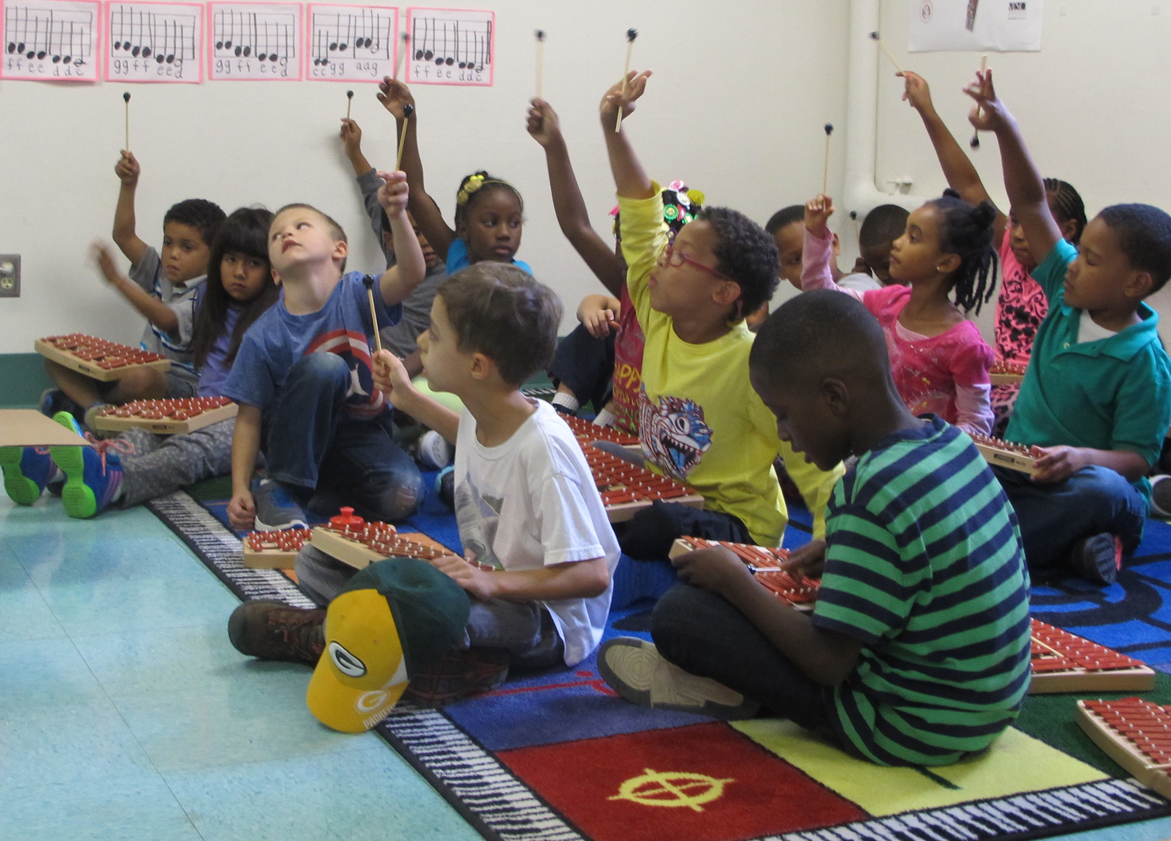 Woodlands' students learn tone and rhythm while playing xylophones in music class, one of the specialty classes incorporated into the curriculum. (Photo by Molly Rippinger)
