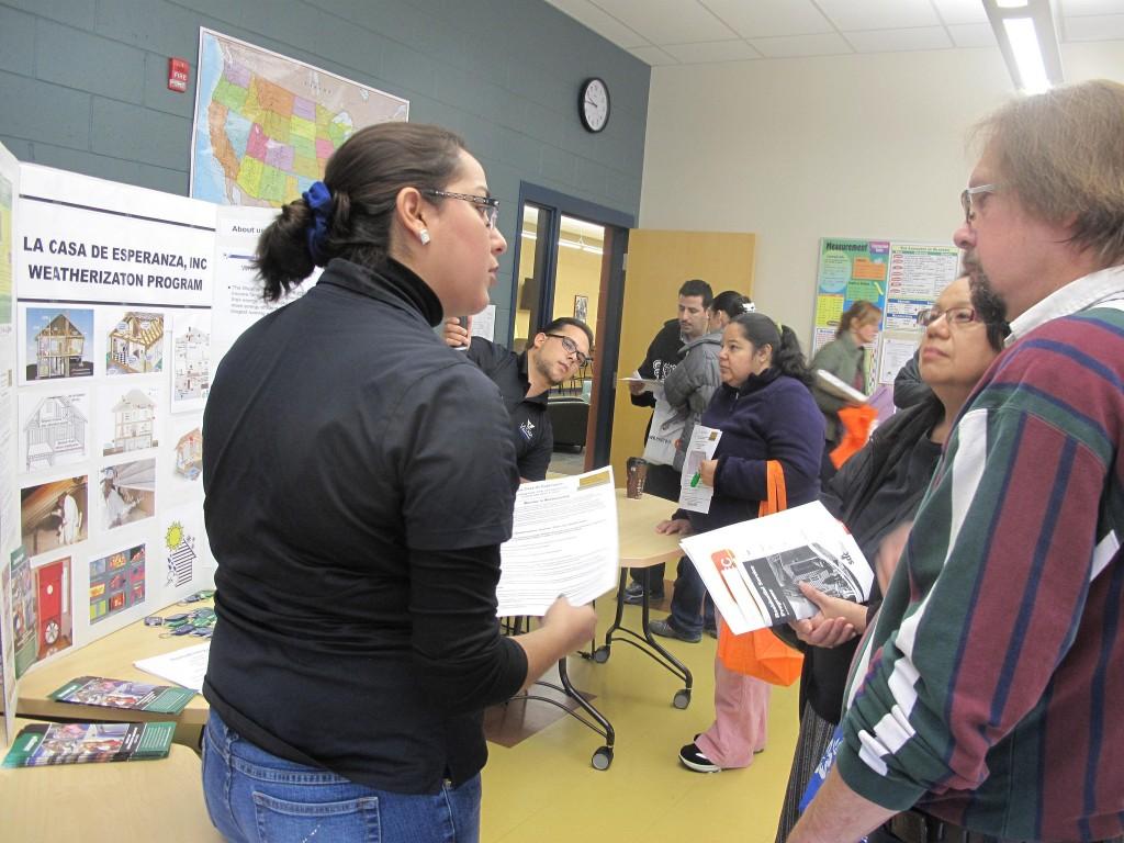 Cynthia Rodriguez, outreach coordinator at La Casa de Esperanza, Inc., explains the weatherization program to attendees. (Photo by Teran Powell)