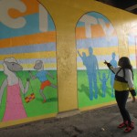 Muralist paints the story of Silver City, with help from the community