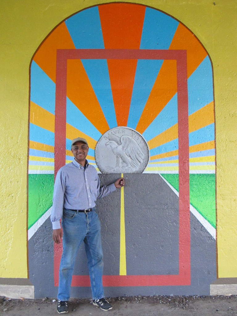 The silver coin in artist Reynaldo Hernandez's mural represents the history of Silver City. (Photo by Teran Powell)