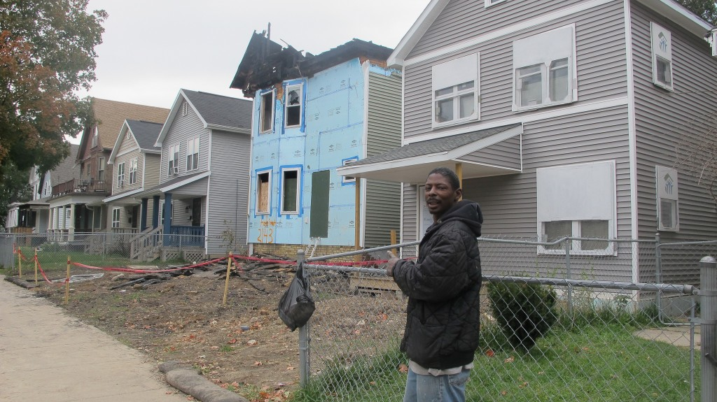 Harvey Johnson, a retired construction worker, is optimistic that the fire will not set back revitalization of the Washington Park neighborhood. (Photo by Molly Rippinger)