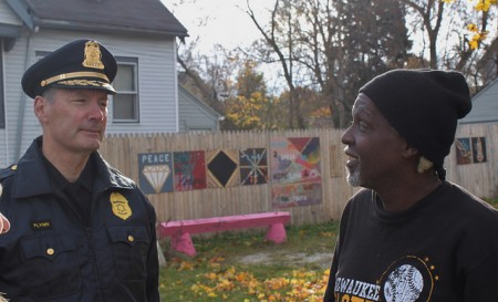 Police Chief Edward Flynn discusses local issues with Harambee resident Darnell Cooper following the award ceremony. (Photo by Matthew Wisla)