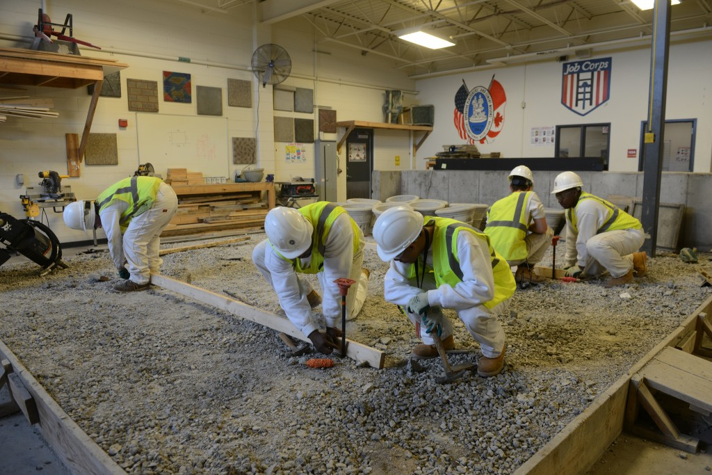 Milwaukee Job Corps students work together during an exercise in a construction trade class. (Photo by Sue Vliet)
