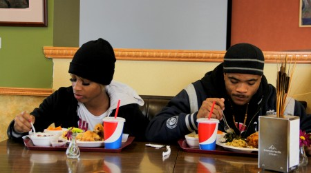 Trina Johnson and Trevon Brenton, both residents of the SOHI neighborhood, enjoy their first taste of Daddy's Soul Food & Grille. (Molly Rippinger)