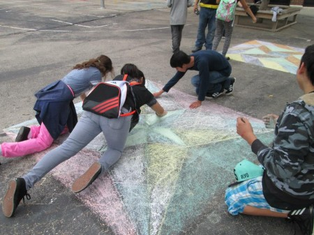 Doerfler students work on the design for a mural at the intersection of 30th and Scott. (Photo courtesy of A.W.E.)
