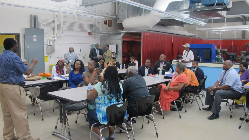 OHMS founder Ezzard White explains his construction training program to representatives from the National League of Cities and My Brothers Keeper in August 2014 at Barack Obama School. (Photo by Andrea Waxman)
