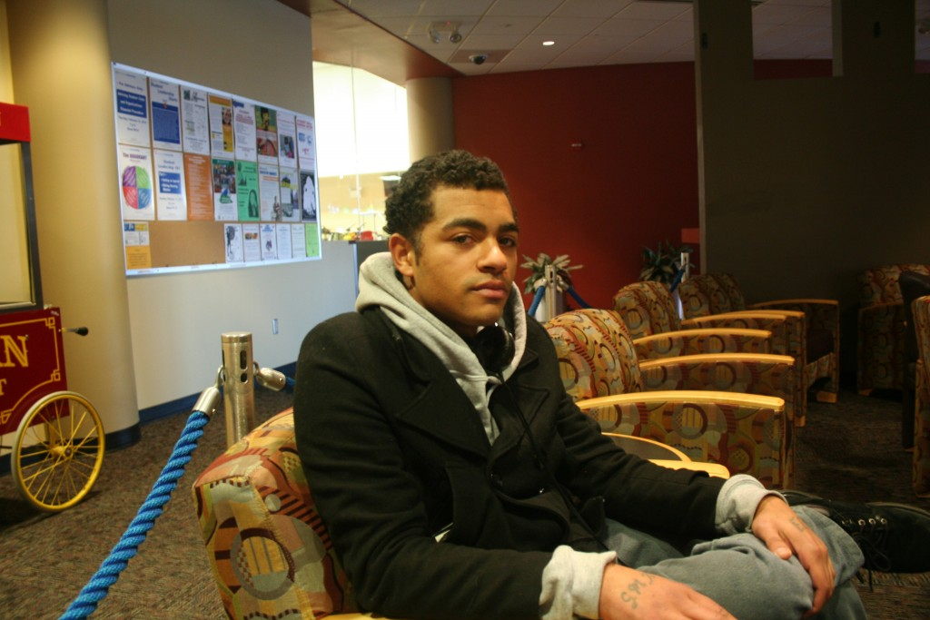 Milagro Jones relaxes in a lounge at MATC's downtown campus, where he is in his first semester. (Photo by Jabril Faraj)
