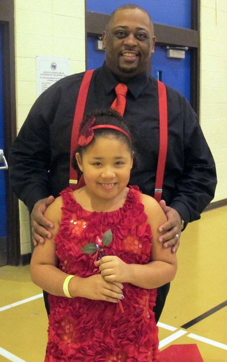 Eric Andrews and his daughter Amaya, 8, attend their first father/daughter dance at North Division High School.