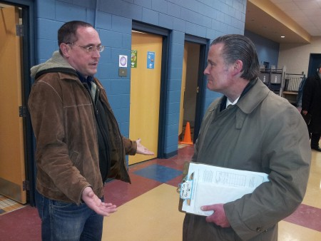 South Side Alderman Bob Donovan listens to Rich Neuber, a community member who is opposed to the streetcar plan. (Photo by Edgar Mendez)