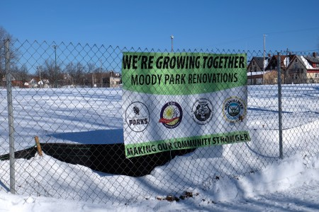 A sign hangs on a fence advertising the planned renovations at Moody Park. (Photo by Sue Vliet)