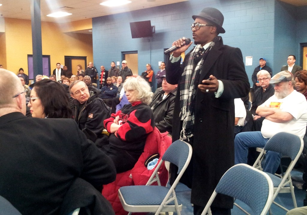 South Side resident Chris Woodley was among several in the crowd who questioned the benefits of the streetcar for central city residents. (Photo by Edgar Mendez)