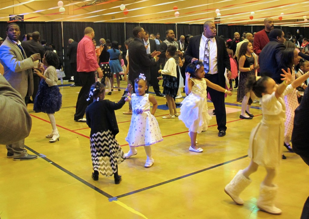 Fathers and daughters enjoy dancing to Bruno Mars.
