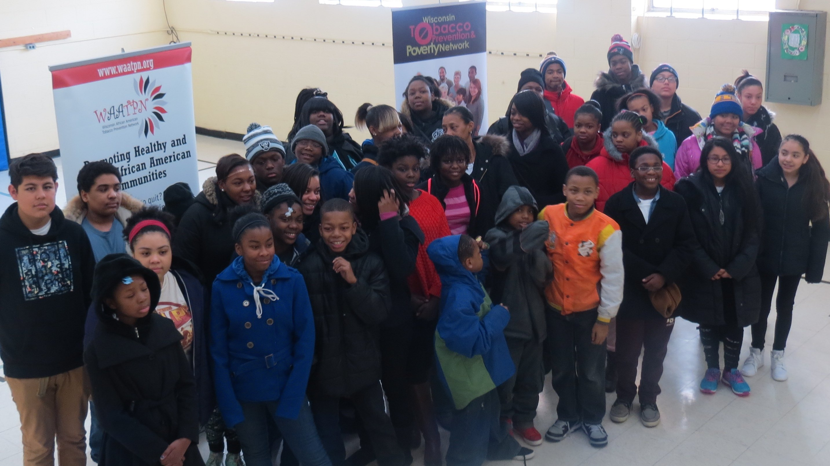 "A group of FACT teens from Milwaukee, along with youth from the Arlington Heights neighborhood, poses for a group picture at the Quality of Life Center, 1530 W. Atkinson Ave., before boarding a bus to see the movie ""Selma."""