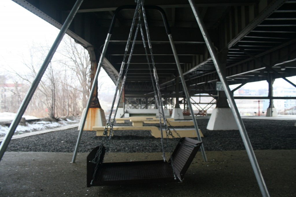 """""""Aunt Ada,"""" a handicap accessible swing, which was installed during the 2014 redesign of the Swing Park, sits in front of the remaining benches from the old Media Garden. (Photo by Jabril Faraj)"""