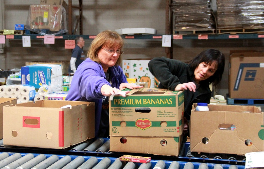 Volunteers from Northwestern Mutual package donations at Feeding America Eastern Wisconsin. (Photo by Molly Rippinger)
