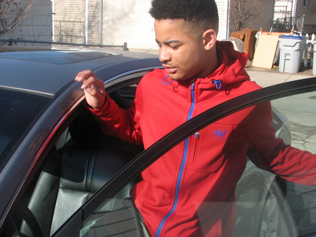 Joshua Leonard, who participated in COA's driver's education program, gets into the vehicle he shares with his mother. (Photo by Brendan O'Brien)