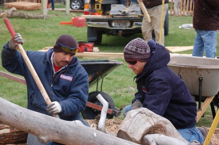 Rolando Morgado Sanchez (left) and Michael Peterson of the Wisconsin Landscape Contractors Association build a balance beam out of tree trunks and branches. (Photo by Andrea Waxman)