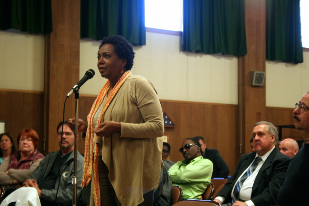 Celia Jackson, 59, addresses a panel of city officials at the Washington Park Senior Center. (Photo by Jabril Faraj)