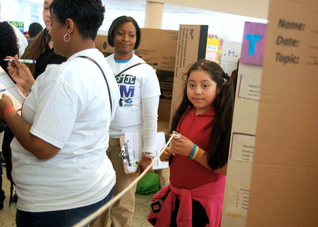 Melissa Sancha, a third grader at Albert E. Kagel Elementary, demonstrates a pulley system at the STEM science fair. (Photo by Molly Rippinger)