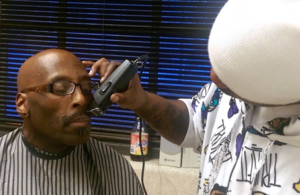 Barber Nelly Hulsey trims James Boswell's mustache at Barbershop Mondays. (Photo courtesy of Damien Smith)