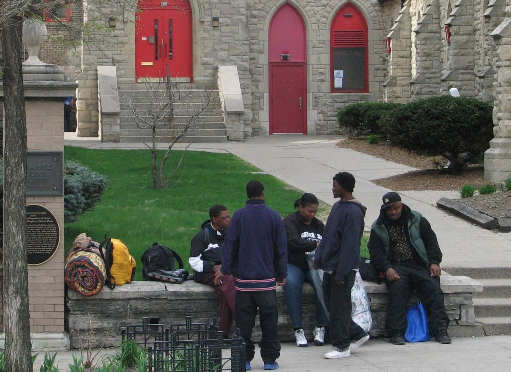 Homeless men mingle outside of The Gathering, a daily meal program held at St. James Episcopal Church, 833 W. Wisconsin Ave. (Photo by Brendan O'Brien)