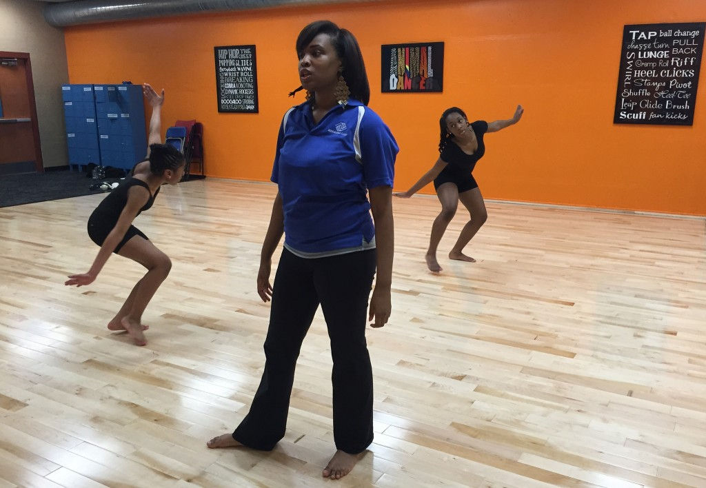 """Jade Robertson, Dance Fuzion teacher at the Davis Boys & Girls Club, directs students in a rehearsal for the May 9 """"Our Lives Matter"""" showcase. (Photo by Andrea Waxman)"""