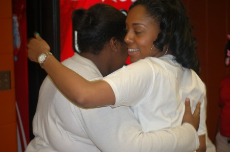 Ebony Haynes encourages a young woman during Denim Day at the Mary Ryan Boys & Girls Club. (Photo by Edgar Mendez)