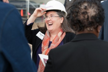 Carmen Pitre greets attendees at the Sojourner Family Peace Center groundbreaking ceremony on Oct. 1 at 619 W. Walnut St. (Photo courtesy of Sojourner Family Peace Center)