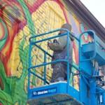 A mural is born: Watch artist create new public artwork