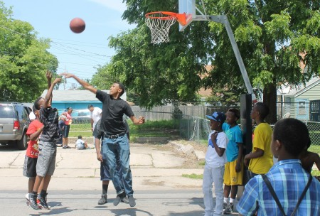 A group of boys plays basketball at the Amani block party. (Photo by Madeline Kennedy)
