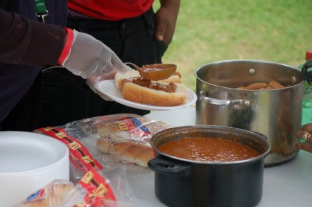 A typical meal, this one featuring a main course of chili dogs, costs the group about $200. (Photo by Edgar Mendez)